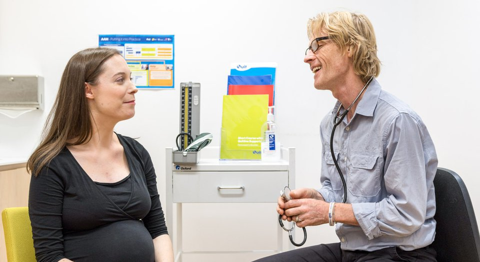 Doctor talks to pregnant patient.jpg