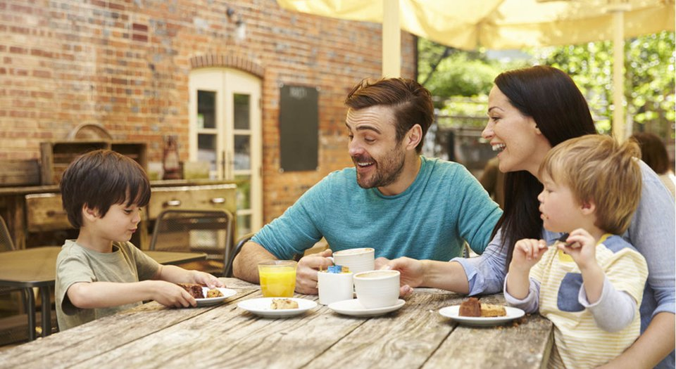 Family laughing together over lunch.jpg