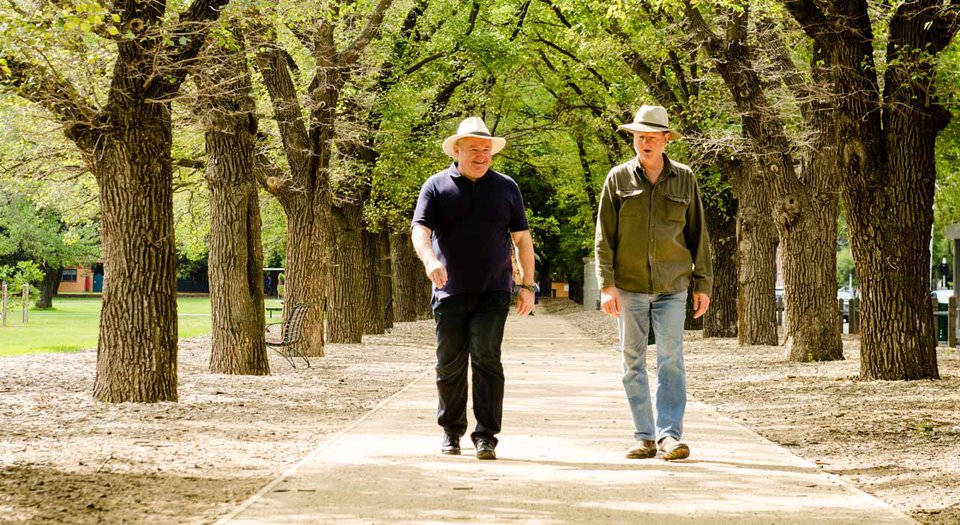 Men walking in park.jpg