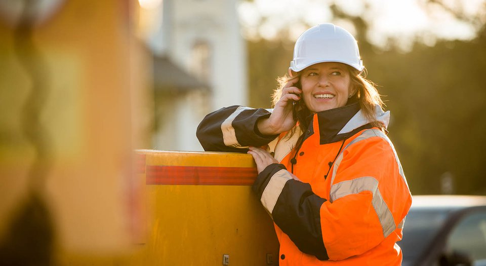 Tradeswoman talks on phone.jpg