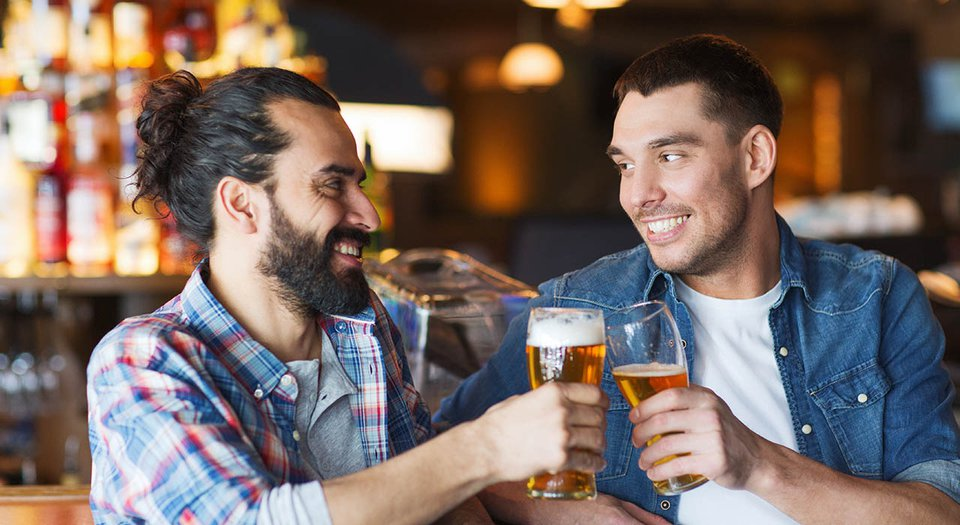 Two friends cheers holding beers.jpg