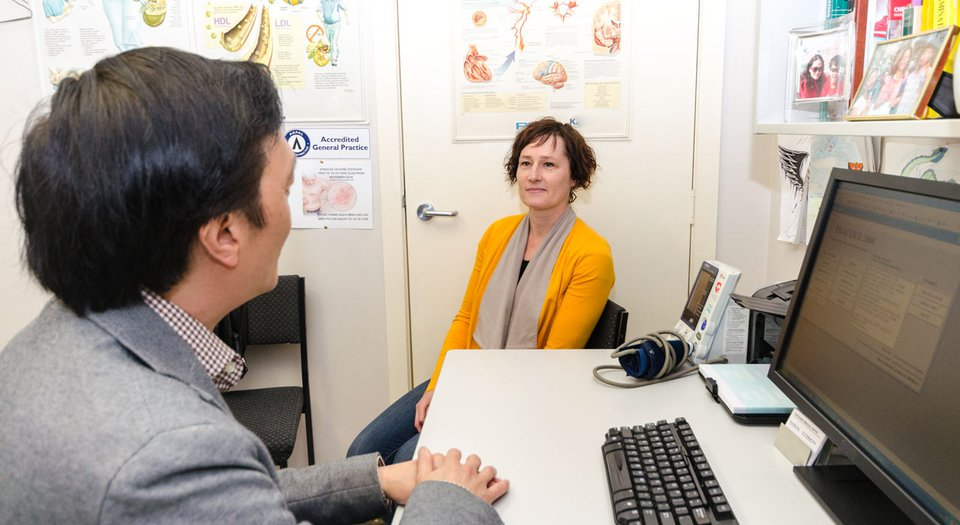Woman sits in doctor's clinic.jpg