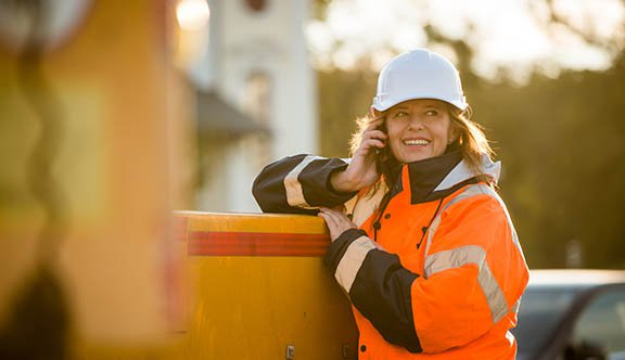 Worker talks on phone smiling photo.jpg